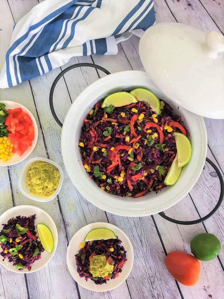 Mexican salad with guacamole, lime, tomato, corn