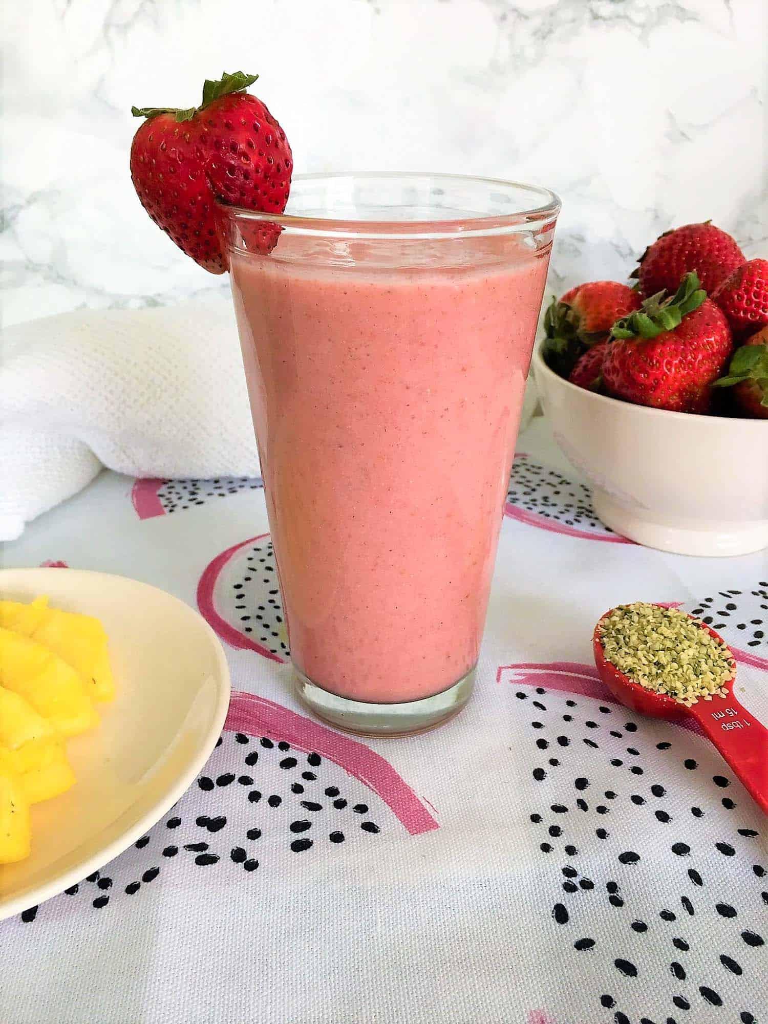 strawberry smoothie with strawberry garnish