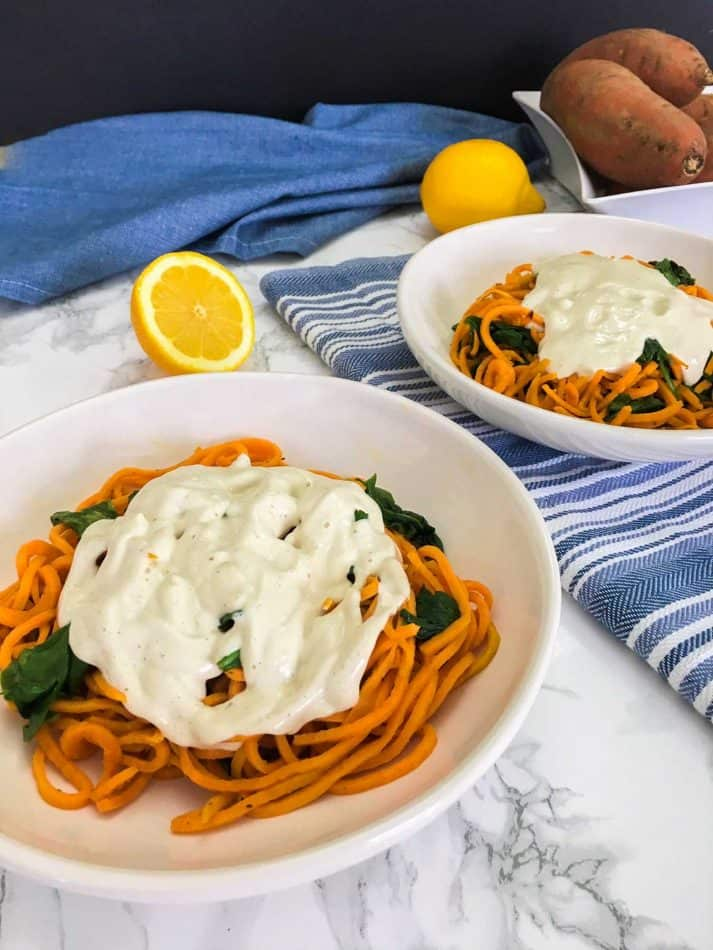 sweet potato noodles with vegan alfredo sauce over top