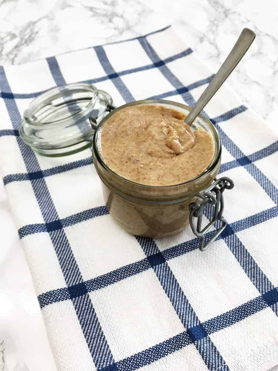 almond butter in jar with spoon
