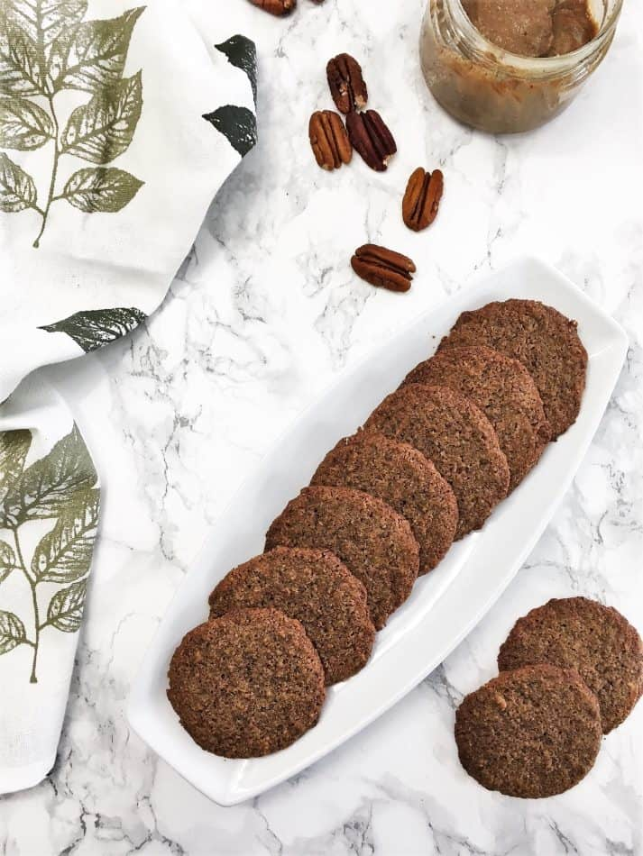 cookies in white platter with pecans scattered around