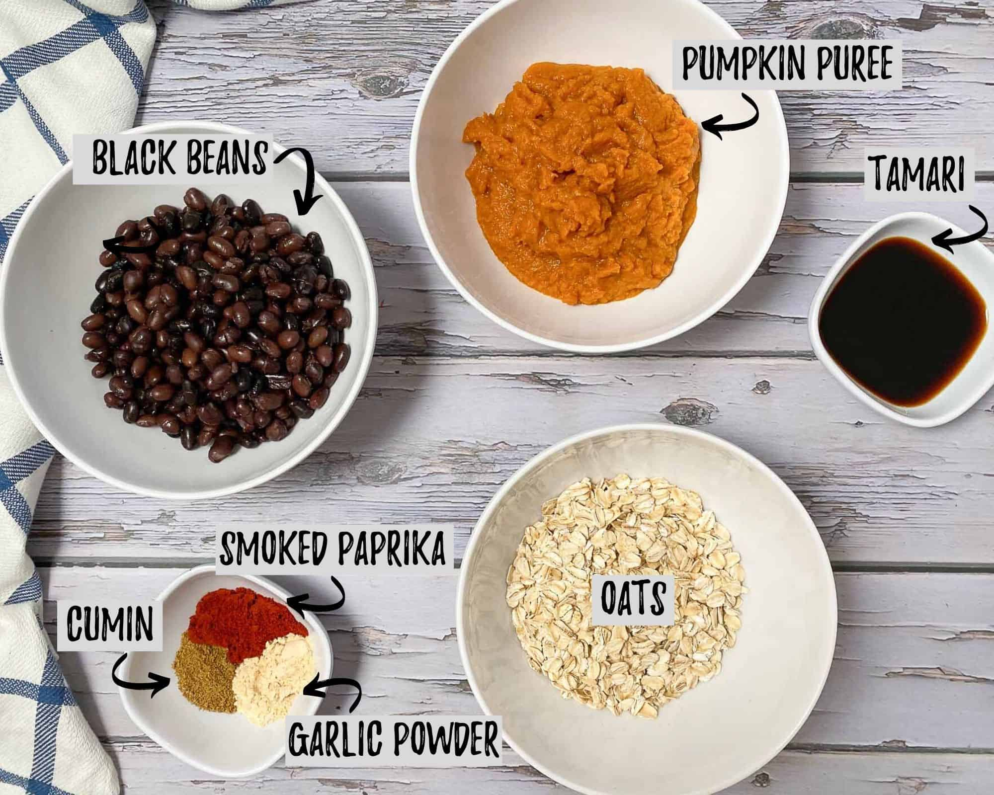 bowl of mashed pumpkin, bowl of black beans, bowl of oats and seasoning