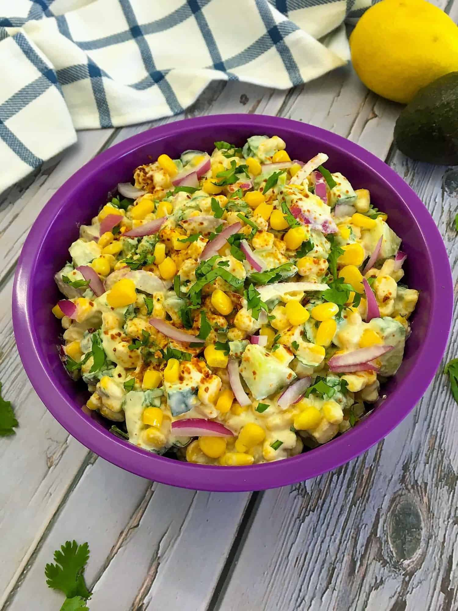 corn salad in purple bowl