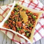 cowboy caviar in white square dish on red and white towel