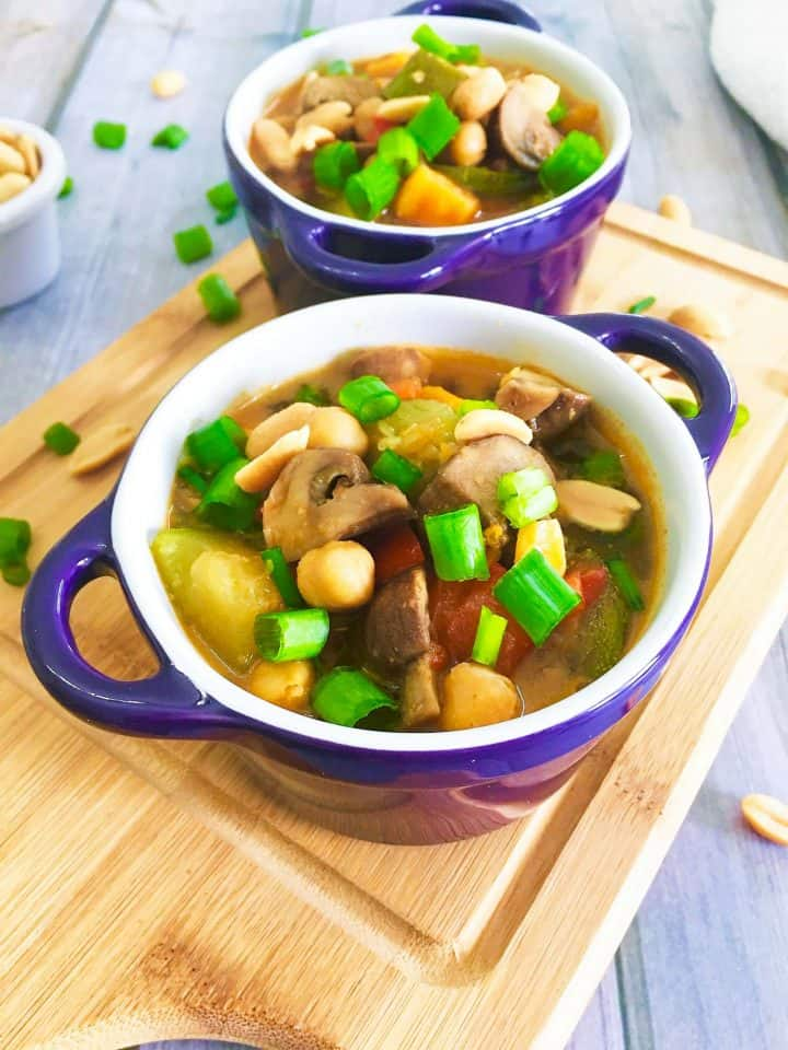 green onion garnished on thai peanut chickpea soup