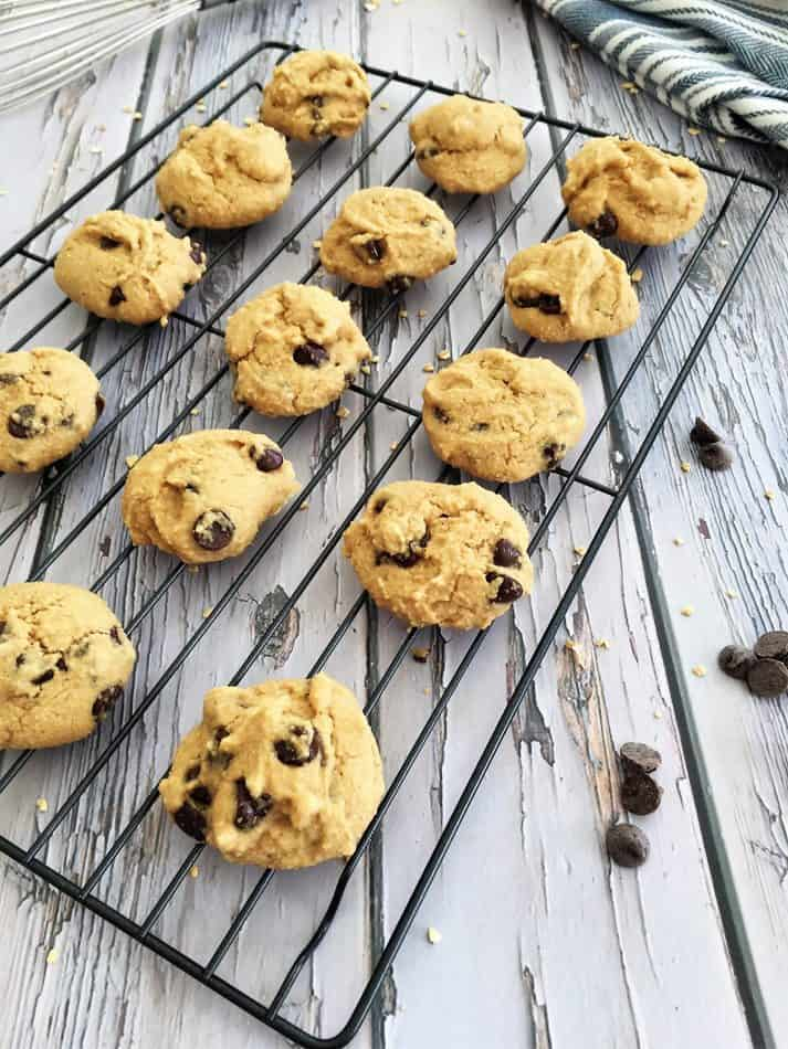cookies on wire rack with chocolate chips scattered