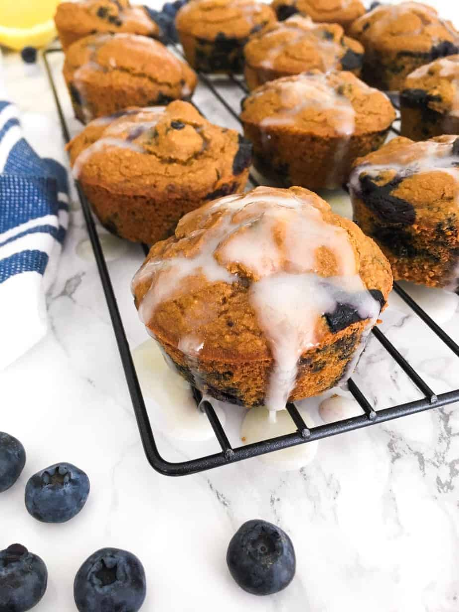 muffins on cooling rack with glaze dripping down