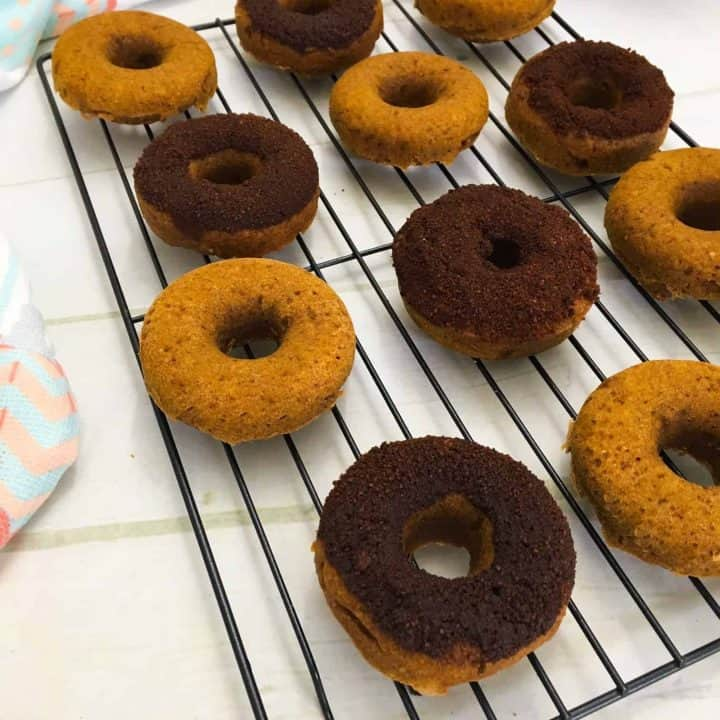 pumpkin donuts on wire rack with glaze