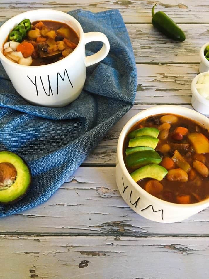 chili in two bowls with avocado garnish