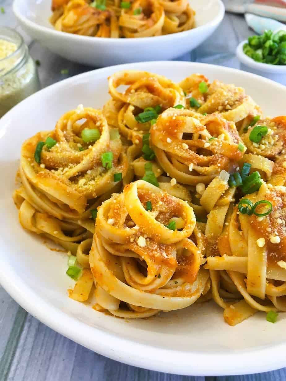 close up of fettuccini pasta in pumpkin sauce