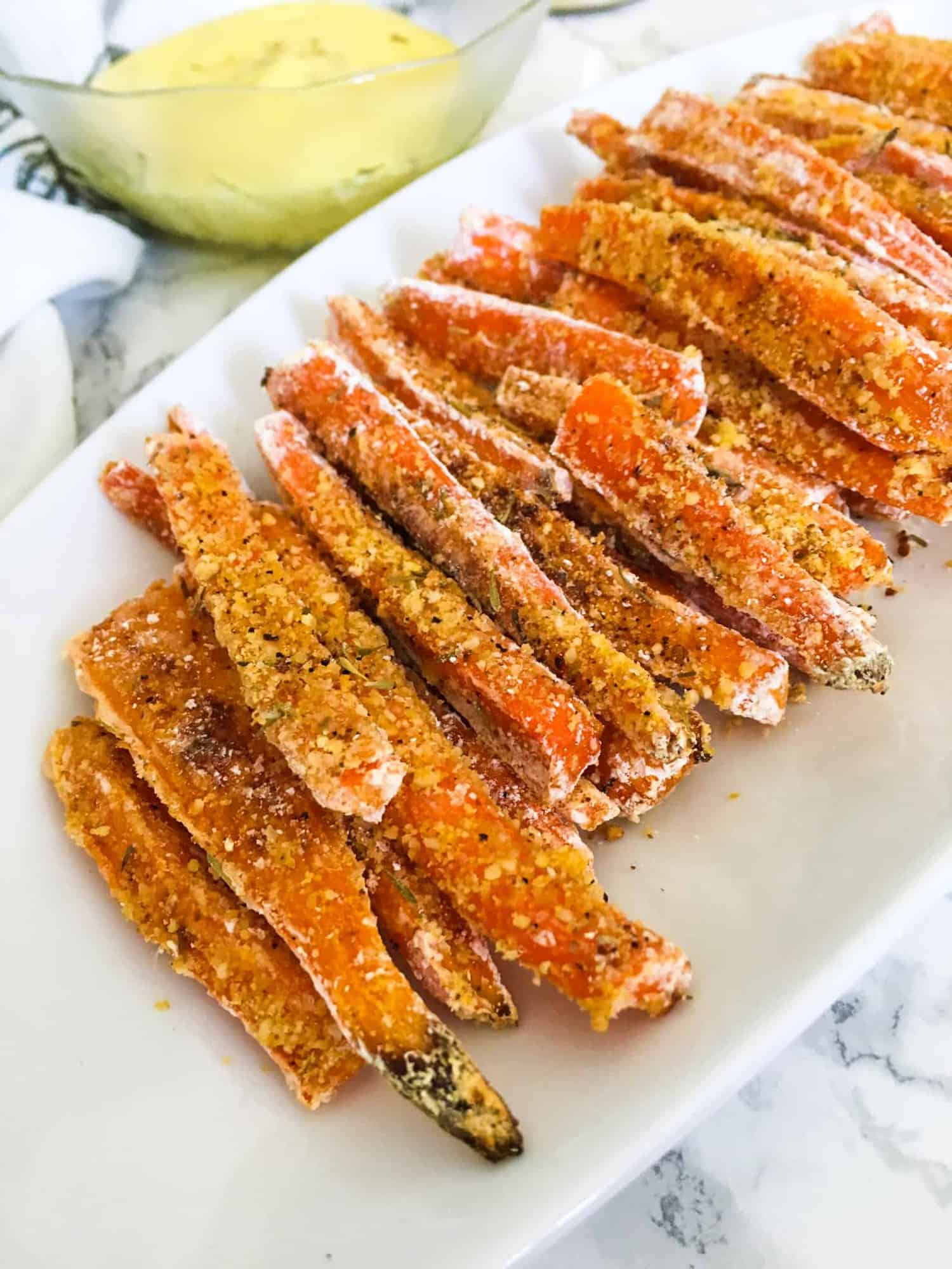 carrot fries on white serving platter