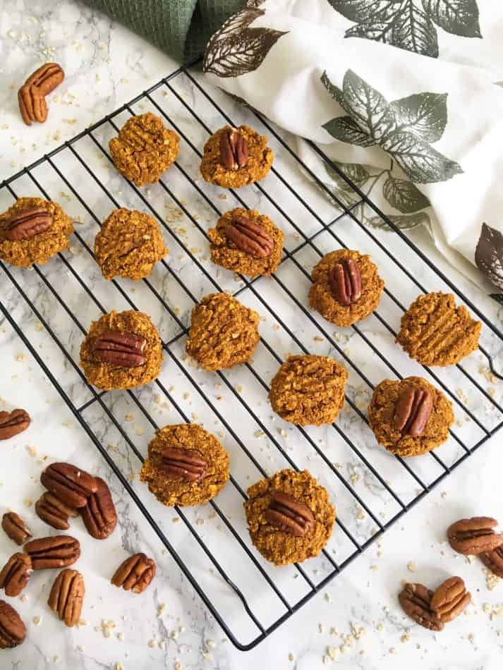cookies on wire rack with pecans sccattered around