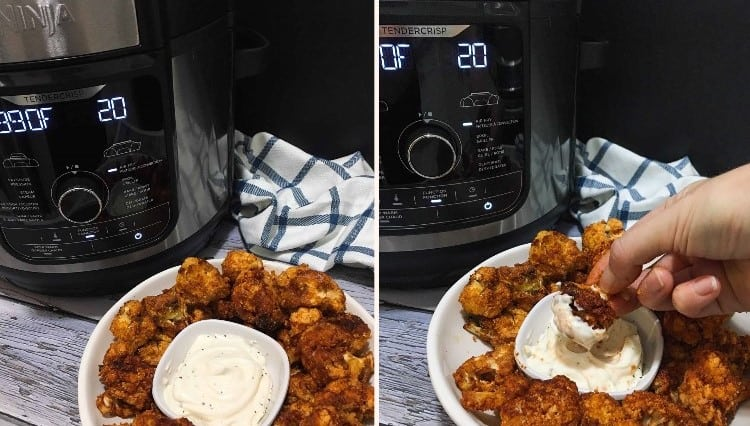 Air fryer in background with bowl of cauliflower florets in front and hand dipping one into ranch dip.