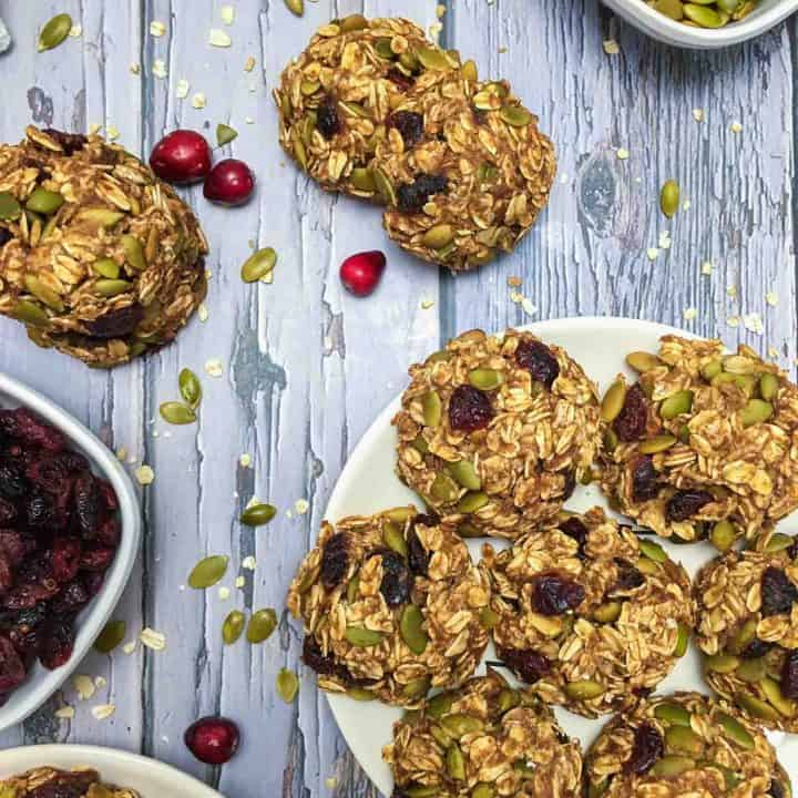 plate of oatmeal cranberry cookies on grey deck