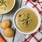 bowl of chestnut soup with potatoes and carrot in background