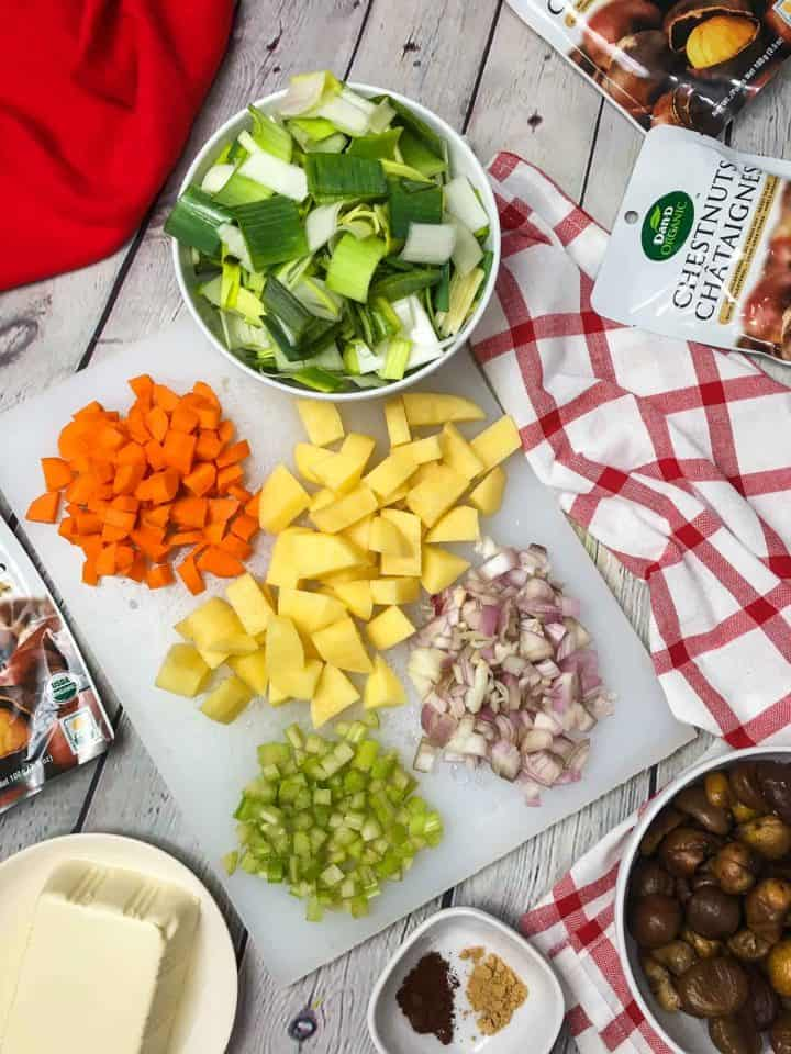 cutting board with chopped vegetables on top