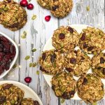 plate of oatmeal cranberry cookies on grey deck.