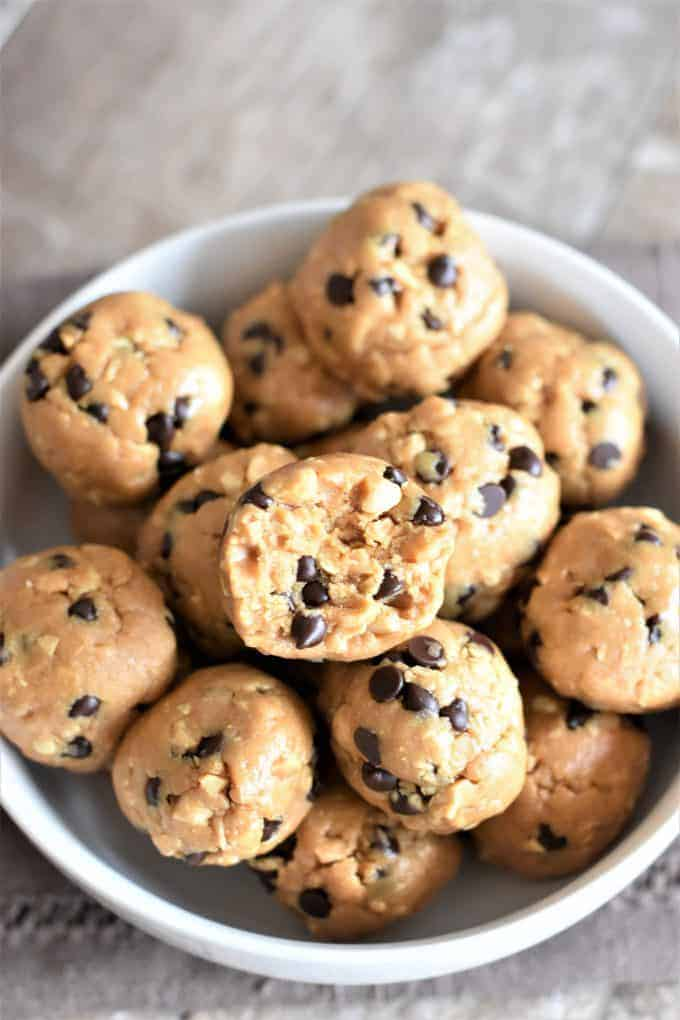 peanut butter energy balls with chocolate chips in white bowl