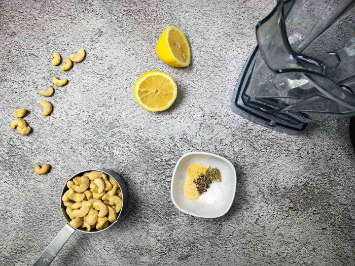 cashews, lemons and seasonin on concrete surface