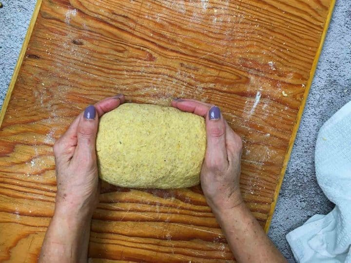 ball of dough for gnocchi on large cutting board