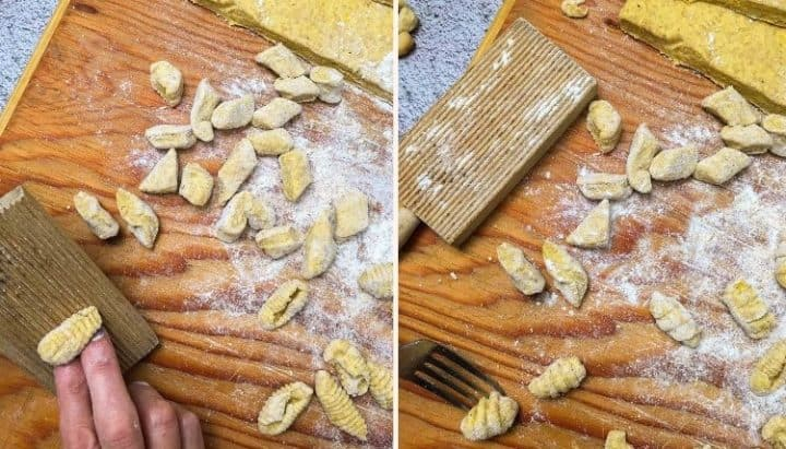 making ridges in vegan gnocchi with fork and gnocchi board