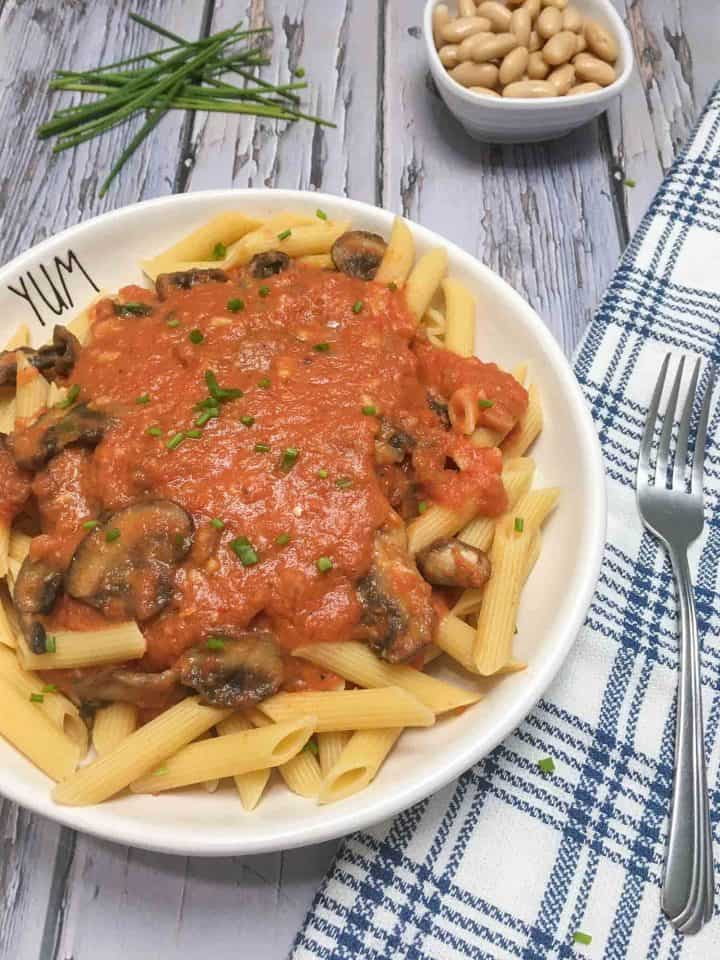 plate of penne alla vodka garnished with parsley
