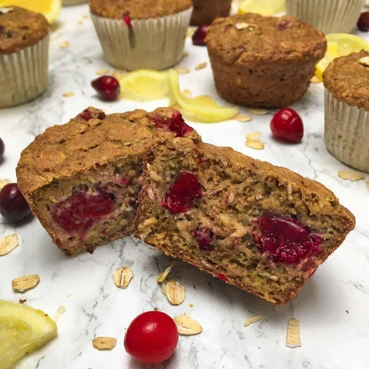Cranberry muffin sliced in half to expose cranberries inside.