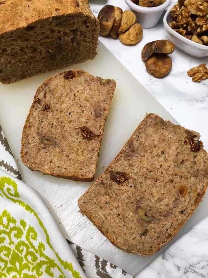 sliced whole wheat fig and walnut bread on cutting board