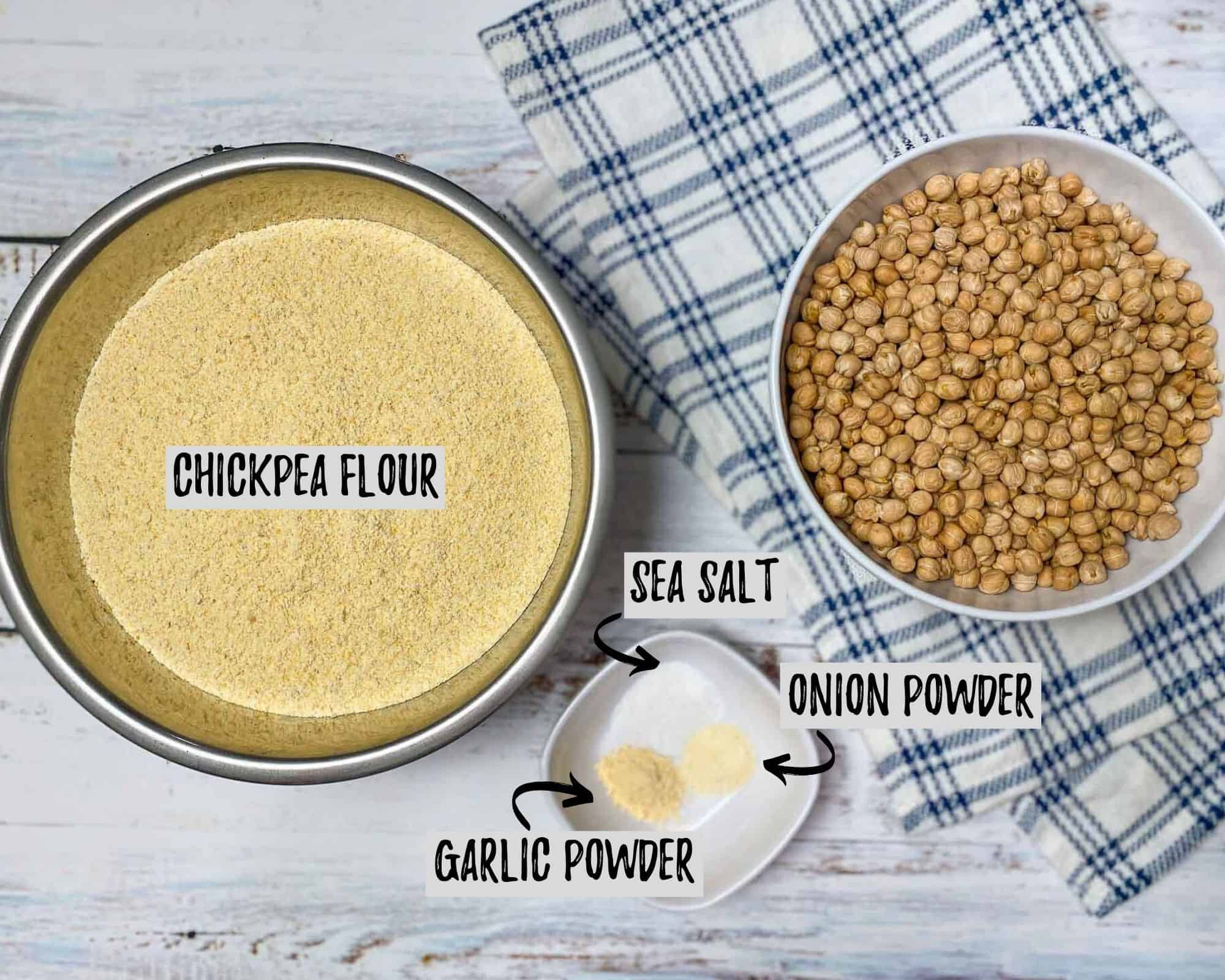 bowl of flour and bowl of chickpeas with blue and white towel underneath