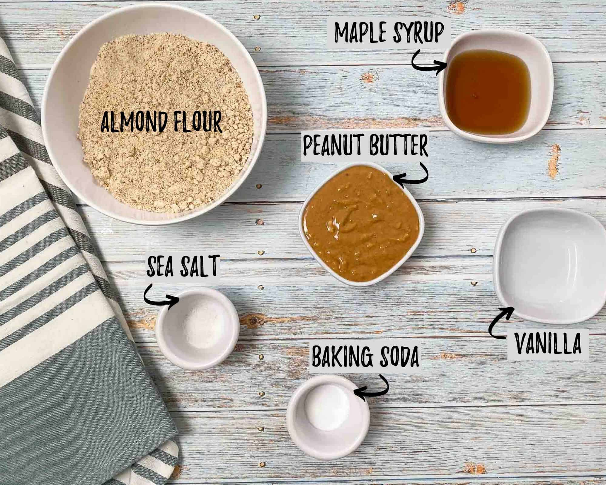 bowl of flour, bowl of peanut butter, bowl of maple syrup, cup of vailla, cup of salt and baking soda