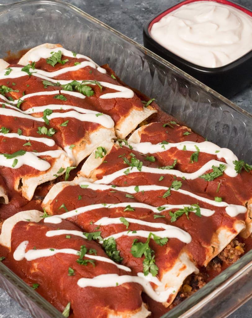 enchiladas in baking dish with cilantro garnish