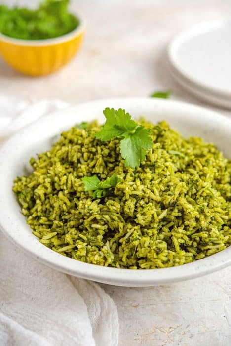 green rice in white bowl