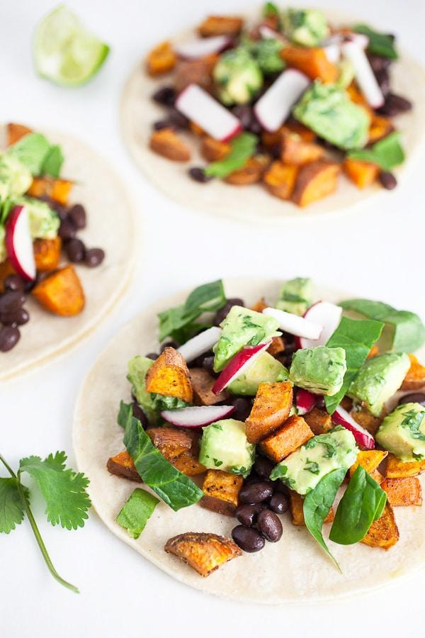 tacos with sweet potato, black beans, cilantro and avocado