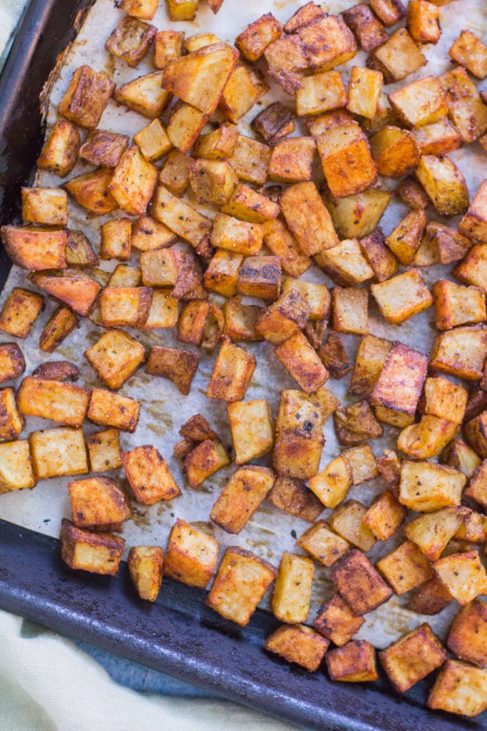 roasted potatoes in baking tray cut into squares