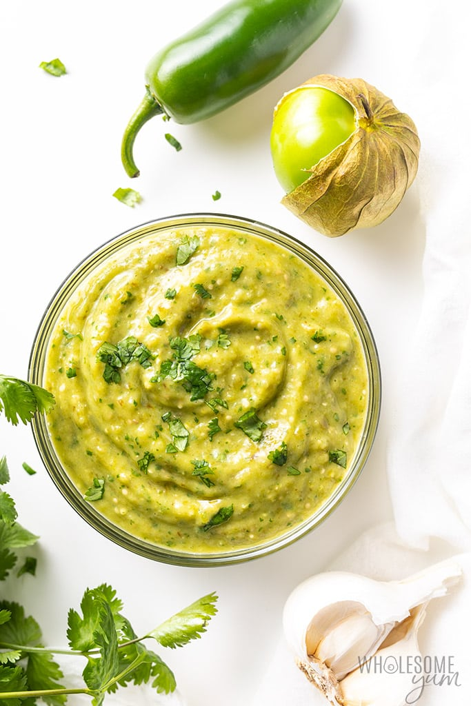 glass bowl of creamy mexican dip with jalapeno beside the bowl