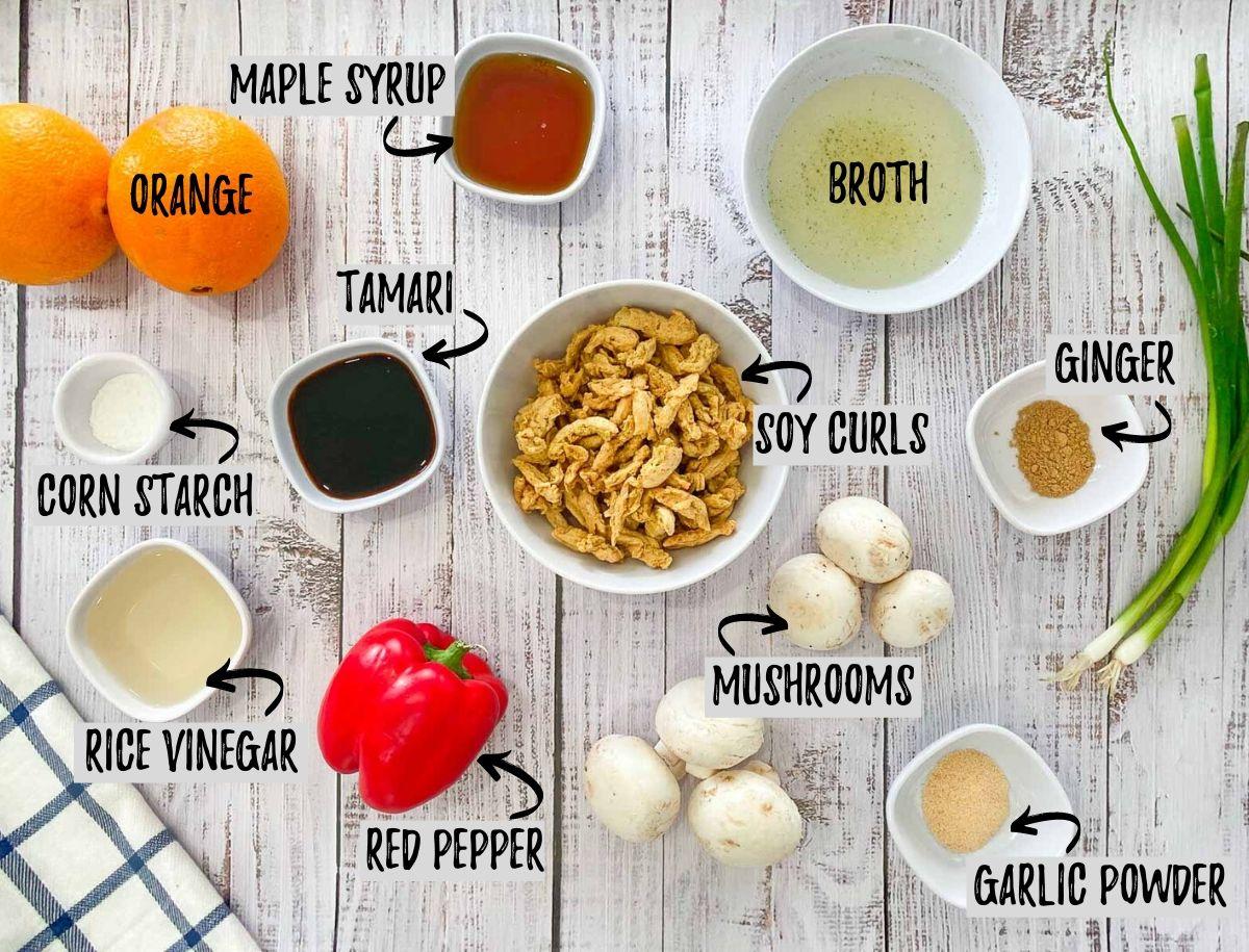 ingredients to make vegan orange chicken: orange, soy curls, broth, maple syrup, mushrooms, peppers, seasoning