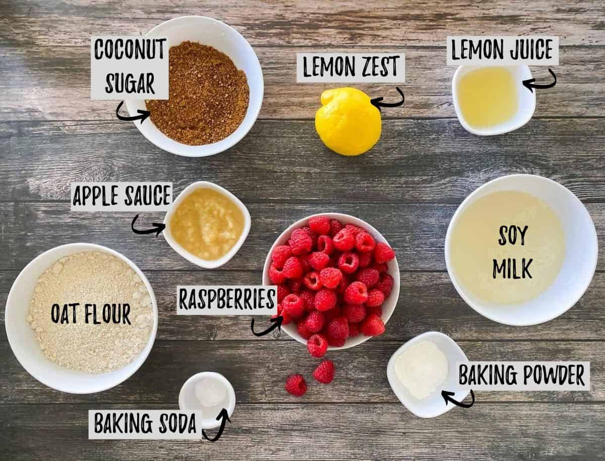 ingredients to make raspberry muffins on brown deck