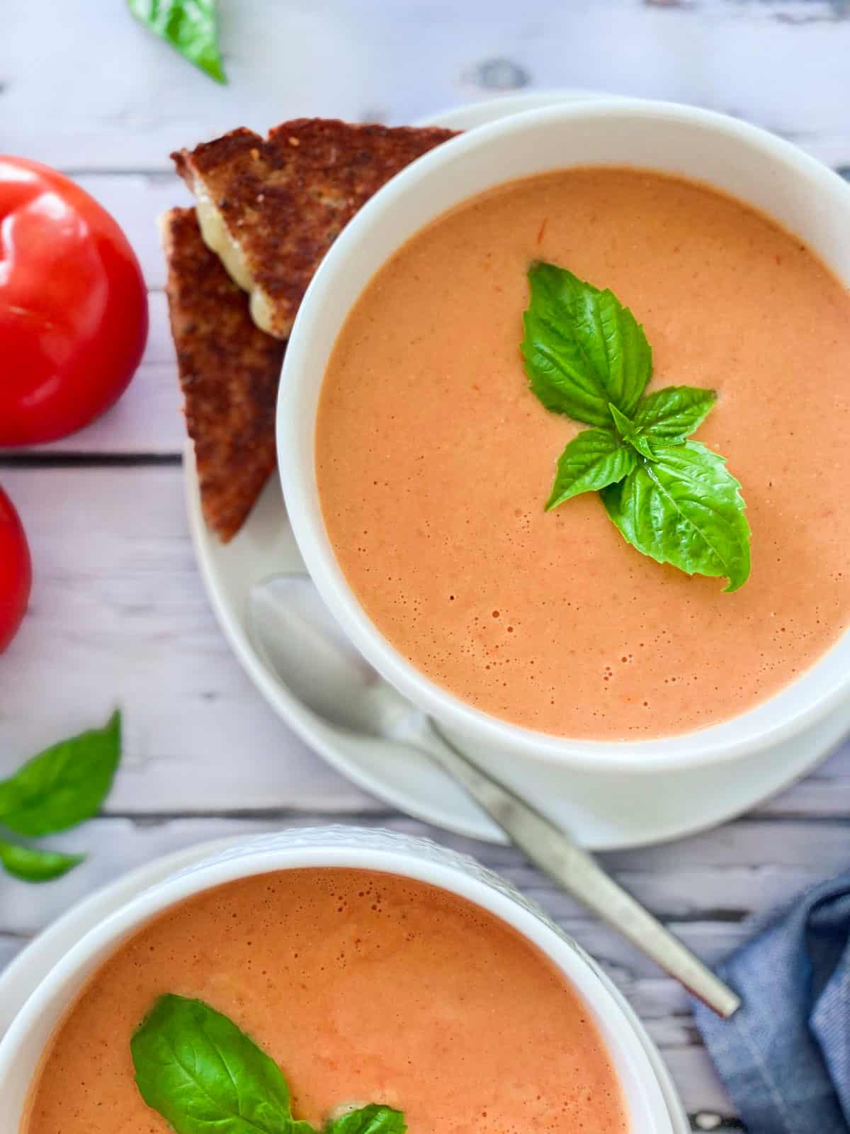 bowl of tomato soup with basil garnish on top