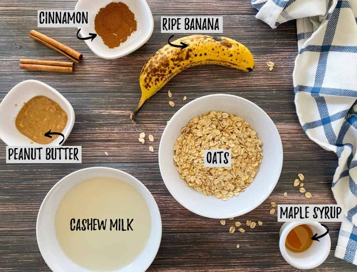 Ingredients to make banana overnight oats on brown deck.