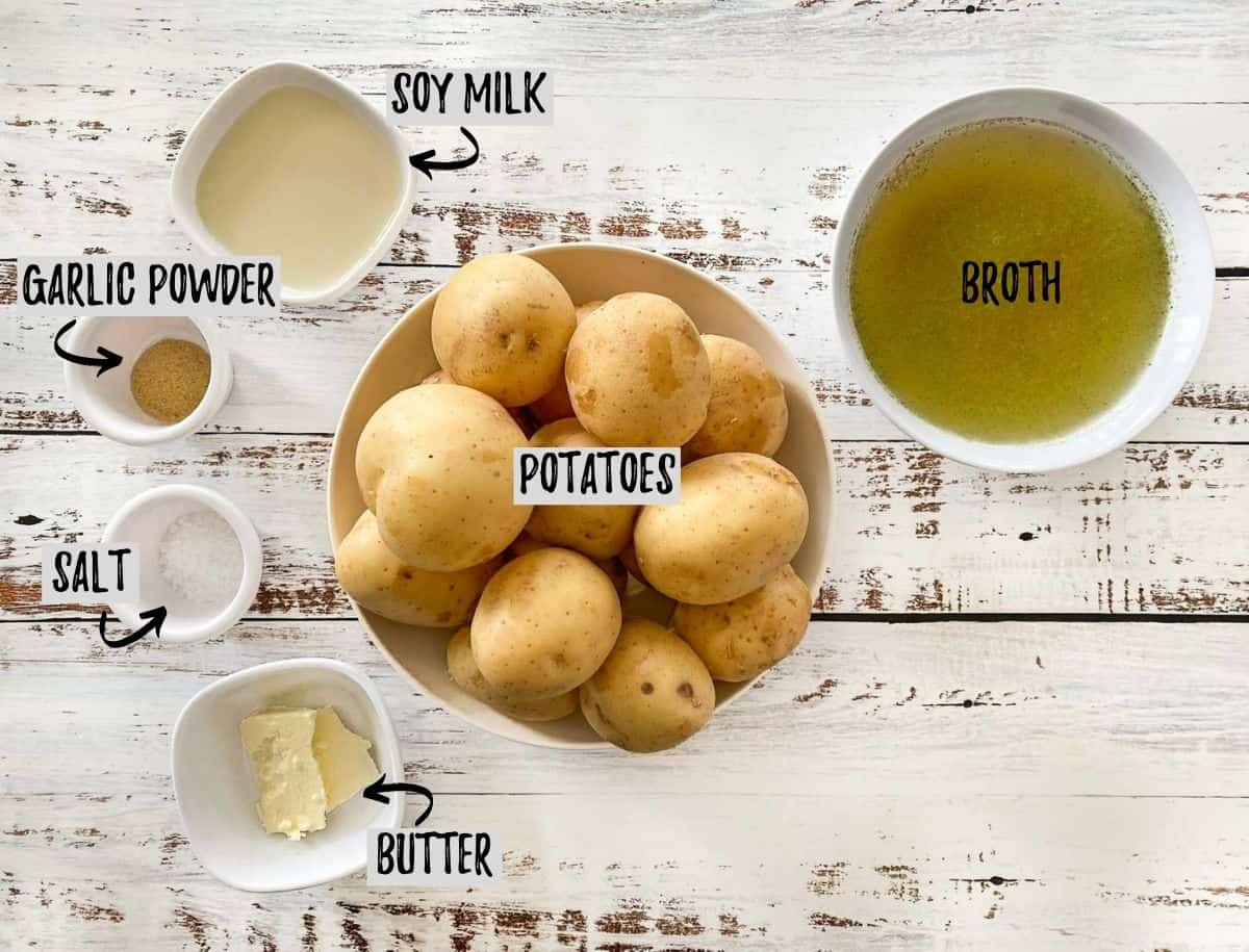 Ingredients to make Instant Pot mashed potatoes in bowls on deck.