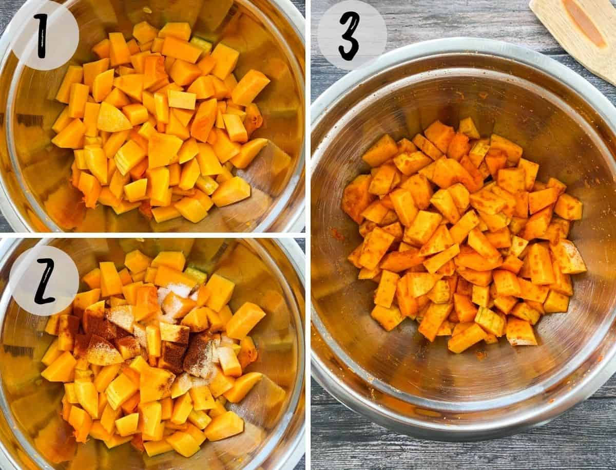 Cubed butternut squash in large mixing bowl being tossed with seasoning.