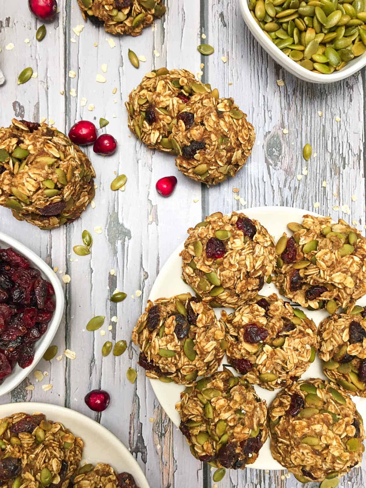 oatmeal cookies with cranberries and pumpkin seeds inside.