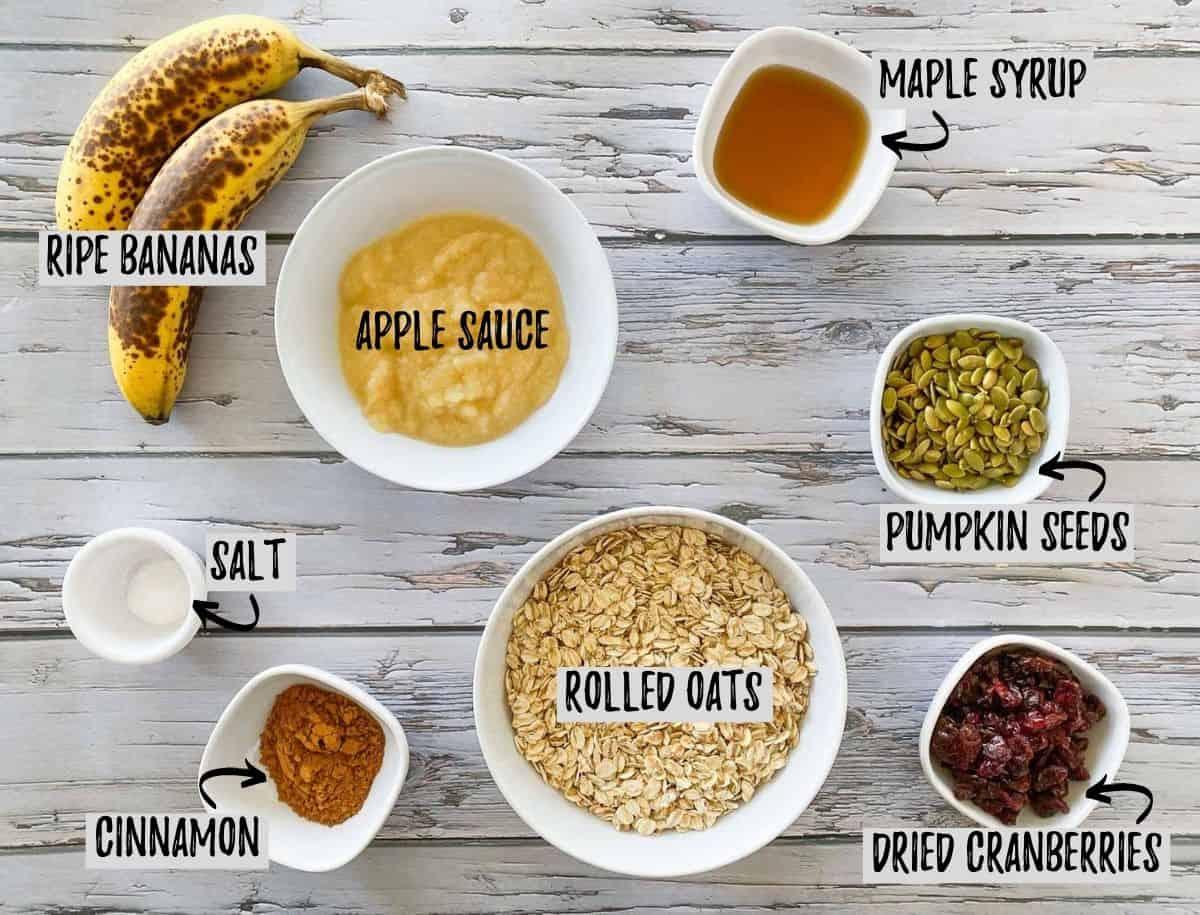 Ingredients to make vegan cranberry oatmeal cookies on grey deck.