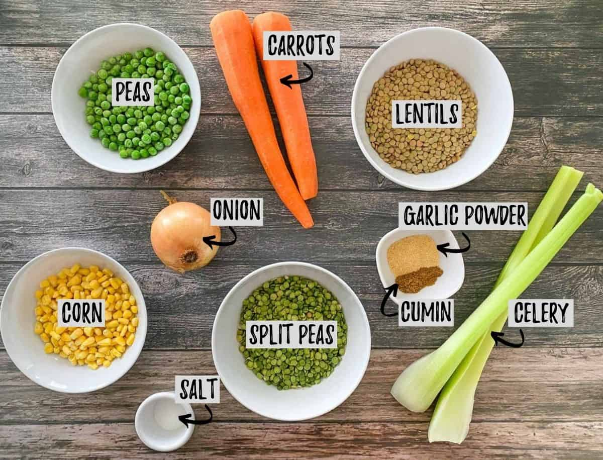 Ingredients to make lentil and split pea soup in bowls on brown deck.