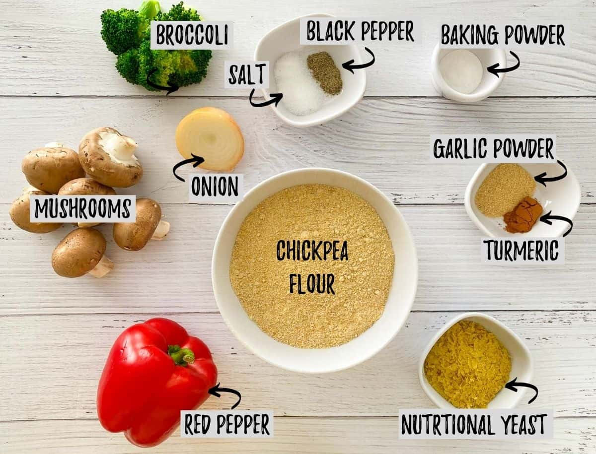 Ingredients needed to make vegan frittata muffins scattered on white deck.