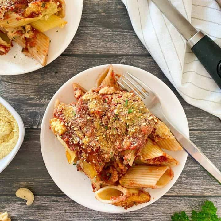 plate of baked pasta dish with fork inside.