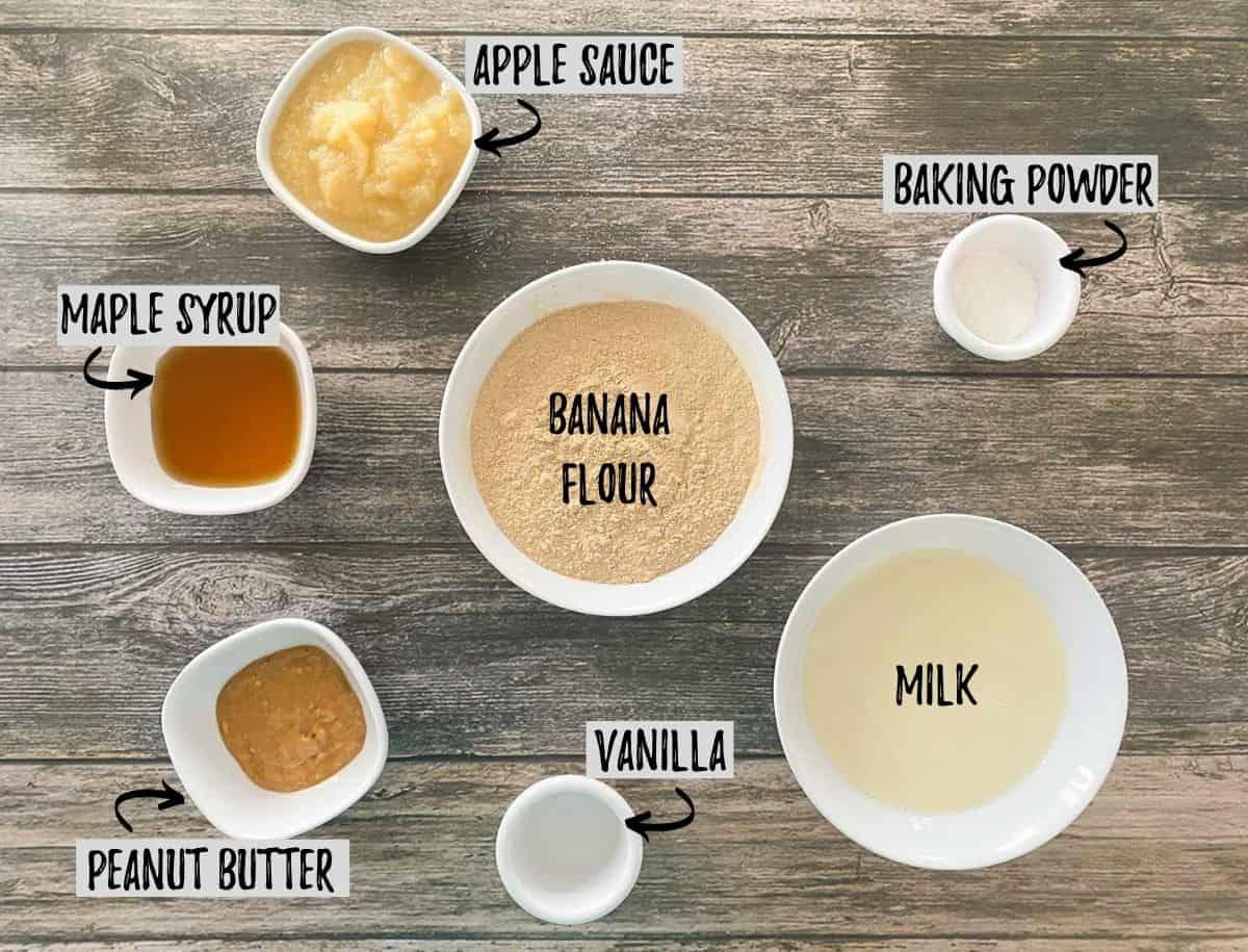 Ingredients to make banana flour pancakes on brown deck.