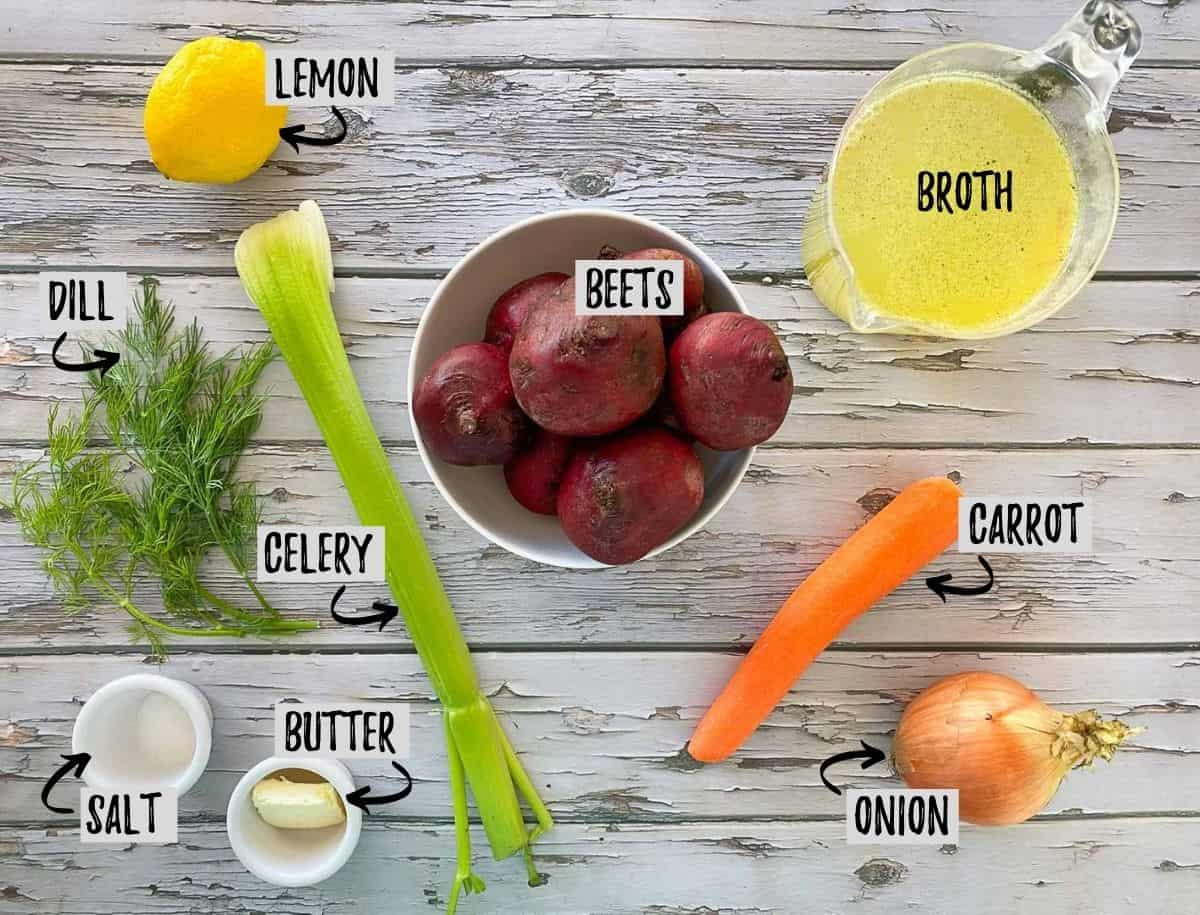 Ingredients needed to make roasted beet soup on grey deck.