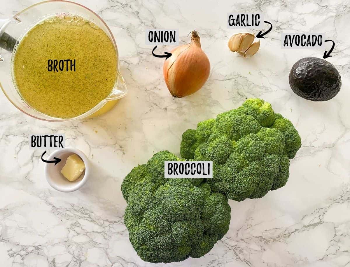 Ingredients to make broccoli soup on marble counter top.