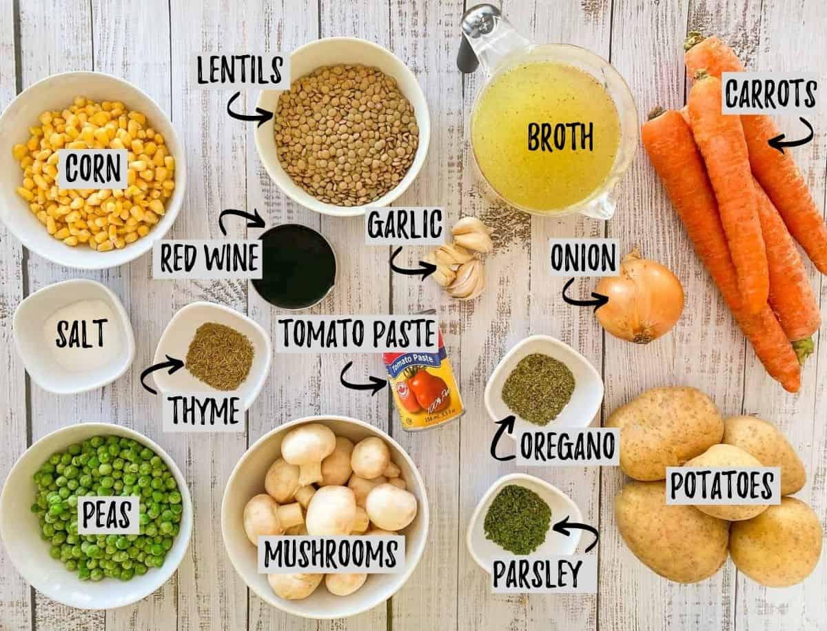 Ingredients needed to make instant pot vegan stew on grey deck.